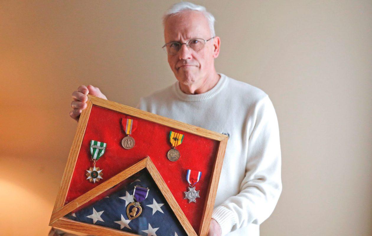 Navy corpsman Michael T. Daniels provided first aid on the battlefields of Vietnam, earning a Purple Heart and other medals. (Robert Kirkham/Buffalo News)