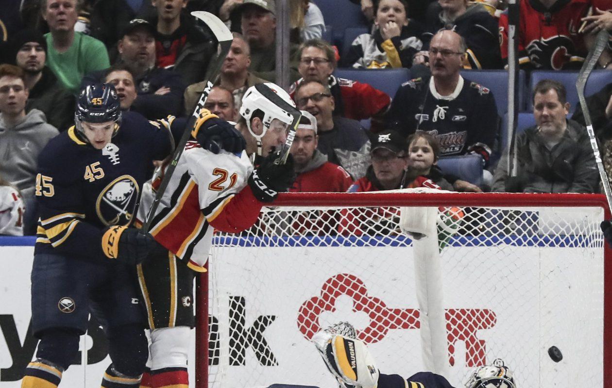 Calgary's Sam Bennett beats Sabres defenseman Brendan Guhle and goalie Chad Johnson to score Wednesday night in KeyBank Center (James P. McCoy/Buffalo News).