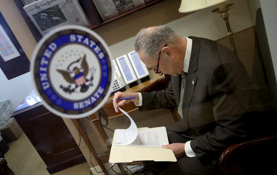 Senate Minority Leader Chuck Schumer (D-NY) goes over his notes Thursday before a news conference at the U.S. Capitol. (Win McNamee/Getty Images)