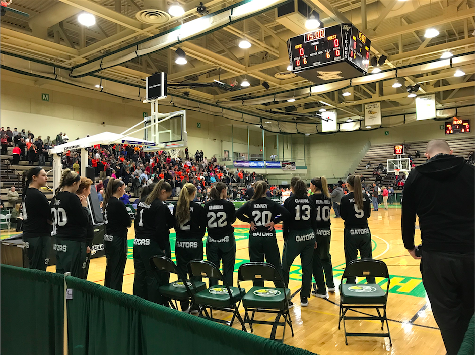 The Allegany-Limestone girls basketball team waits to take the court prior to playing in the NYSPHSAA Class C semifinals. The Gators lost to Syracuse Academy of Science, 55-50.