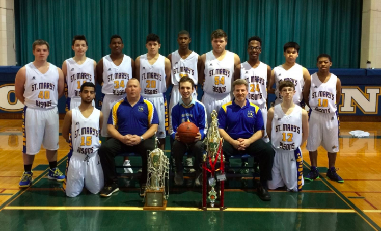 The St. Mary's School for the Deaf boys basketball team won the 2018 ESDAA title. Front row (from left): Kassim Kassim, assistant coach Jim Carmody, manager Jack Kawalec, head coach Kevin LeRoy, Nick Barrus. Standing: Dalton Planty, Ethan Antone, Adnan Abdi, Christian Lawrence, Michael Norris, Ryan Brzezinski, Isa Habeeb, Francis Nguyen, Givon Blackwell. Not pictured: Jonathan Allen, Tyler Burgard. (Courtesy of Jim Carmody)