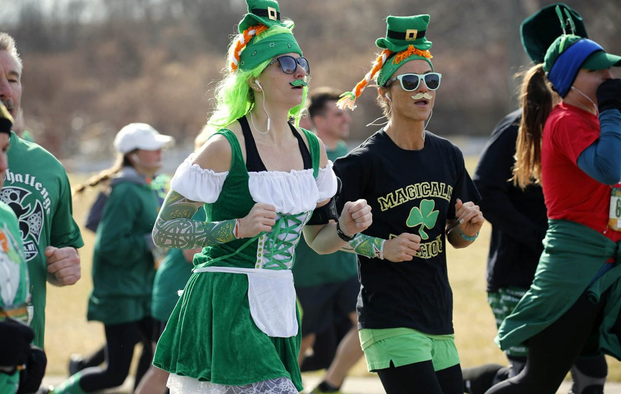 Runners in costume on South Park Avenue while competing in the Buffalo Shamrock Run on March 12, 2016. (Derek Gee/News file photo)