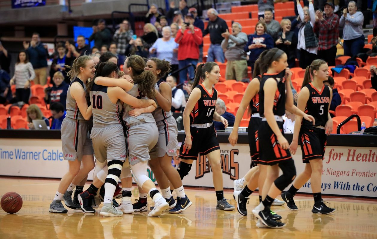 Southwestern celebrates after defeating Wilson for the Section VI Class B-2 girls basketball title. (Harry Scull Jr./Buffalo News)