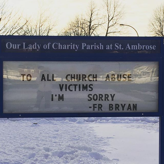 The Rev. Bryan Zielenieski, pastor of Our Lady of Charity at St. Ambrose, placed this sign in front of the church for two Sundays. (courtesy  Our Lady of Charity Parish)