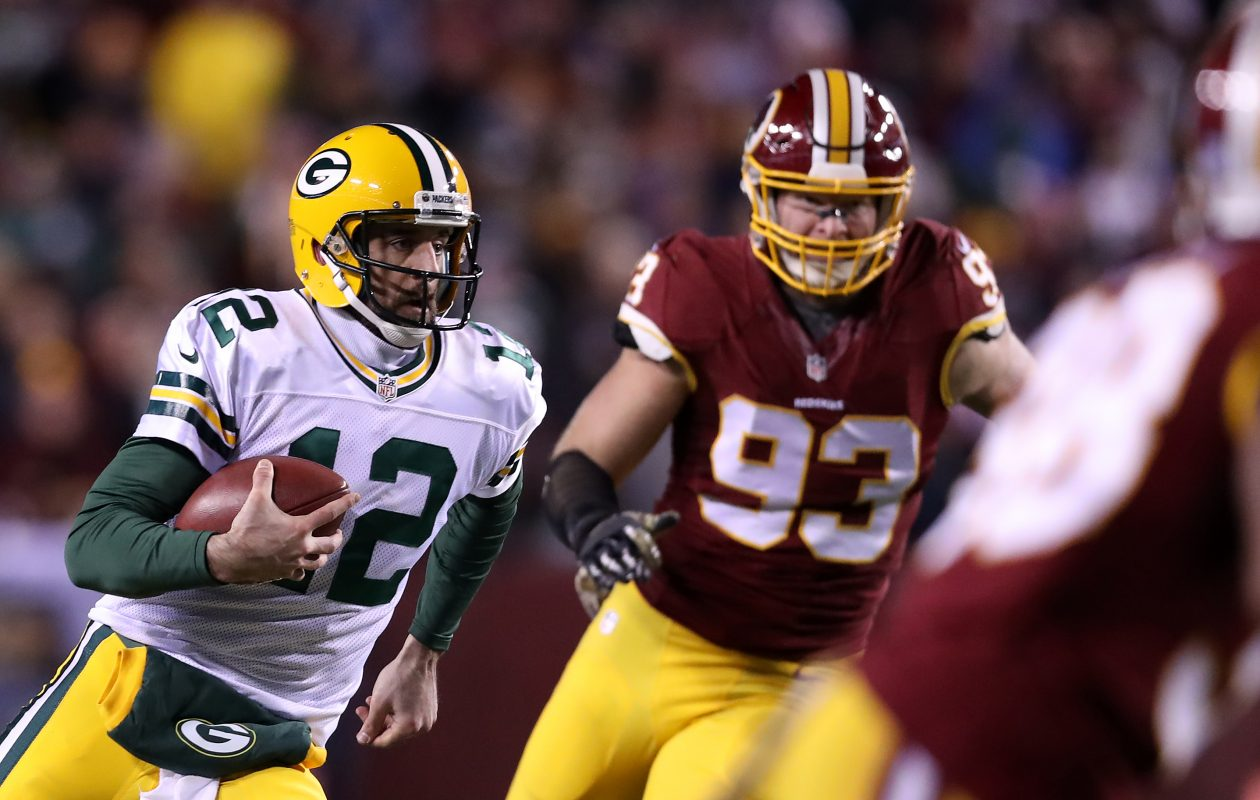 Former Redskins defensive end Trent Murphy, seen chasing down Packers quarterback Aaron Rodgers, is joining the Bills in free agency. (Getty Images)