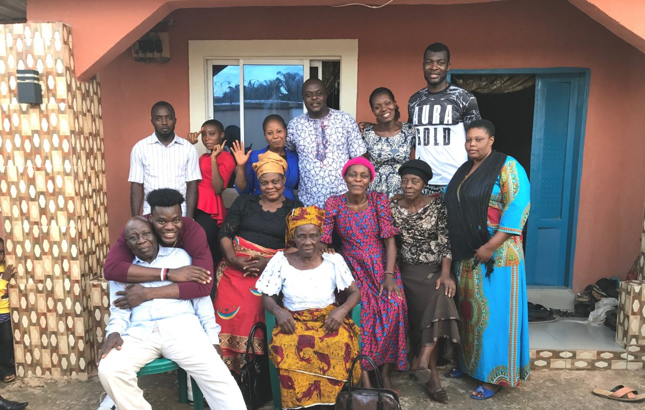 UB forward Ikenna Smart easily stands out as the tallest in the back row in a family photo taken last summer back home in Umuahia, Abia, Nigeria. (Photo courtesty of UB Now, University at Buffalo)