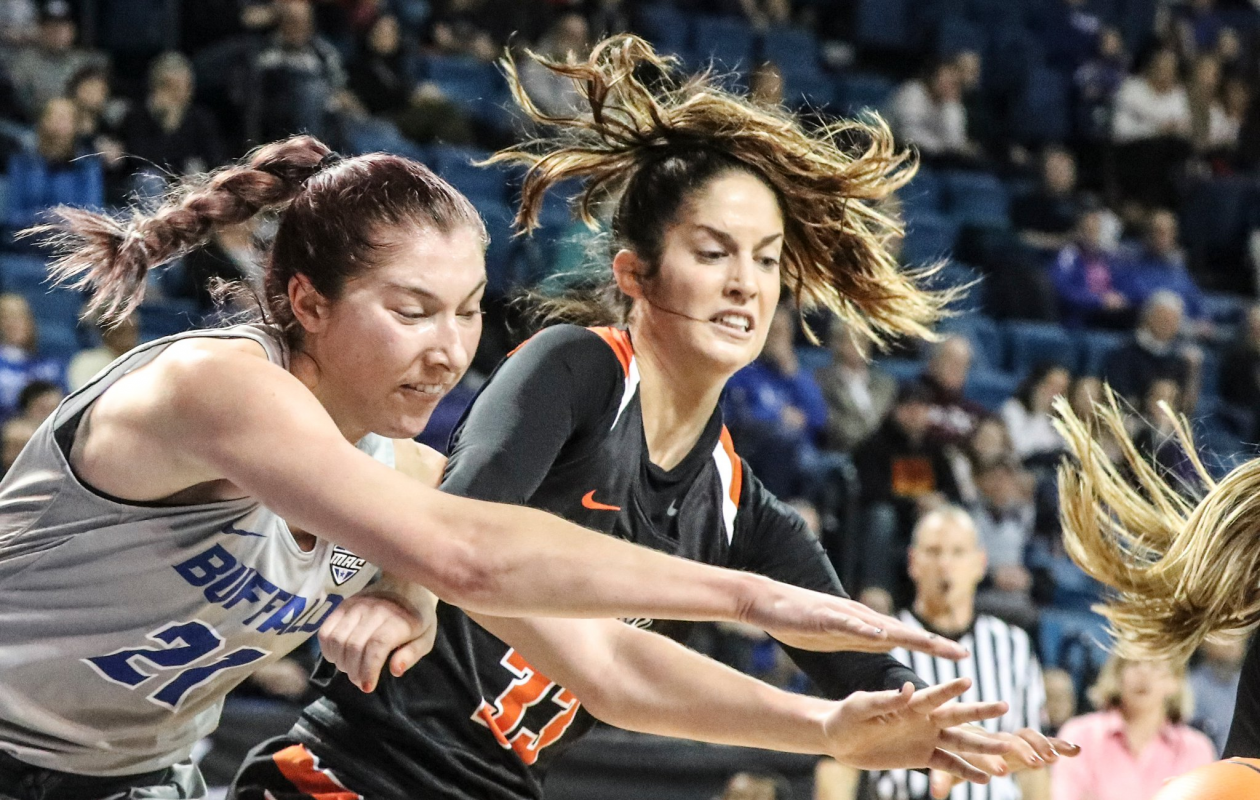 Buffalo Bulls forward Mariah Suchan (21) attempts to bring down a rebound against Bowling Green Falcons guard Haley Puk (33) in the first half at University at Buffalo Alumni Arena in Amherst,NY on Saturday, March 3, 2018.  (James P. McCoy / Buffalo News)