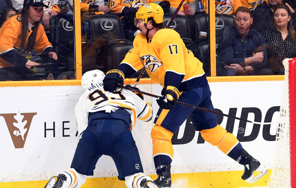Buffalo Sabres defenseman Victor Antipin (93) is hit into the boards by Nashville Predators left wing Scott Hartnell. (USA Today Sports)