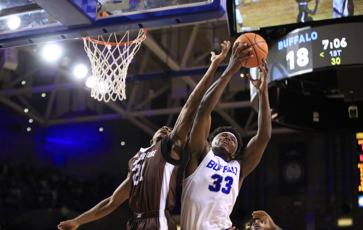 St. Bonaventure forward Iziah Brockington and University at Buffalo's Nick Perkins battle for a rebound during first half action at Alumni Arena on Saturday, Dec. 2, 2017. (Harry Scull Jr./Buffalo News)