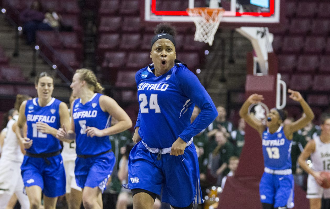 Buffalo guard Cierra Dillard reacts to making a three-point shot in the first half of their game against South Florida in Round One of the NCAA basketball tournament in Tallahassee, Fla., March 17, 2018. (Mark Wallheiser/Special to The News)