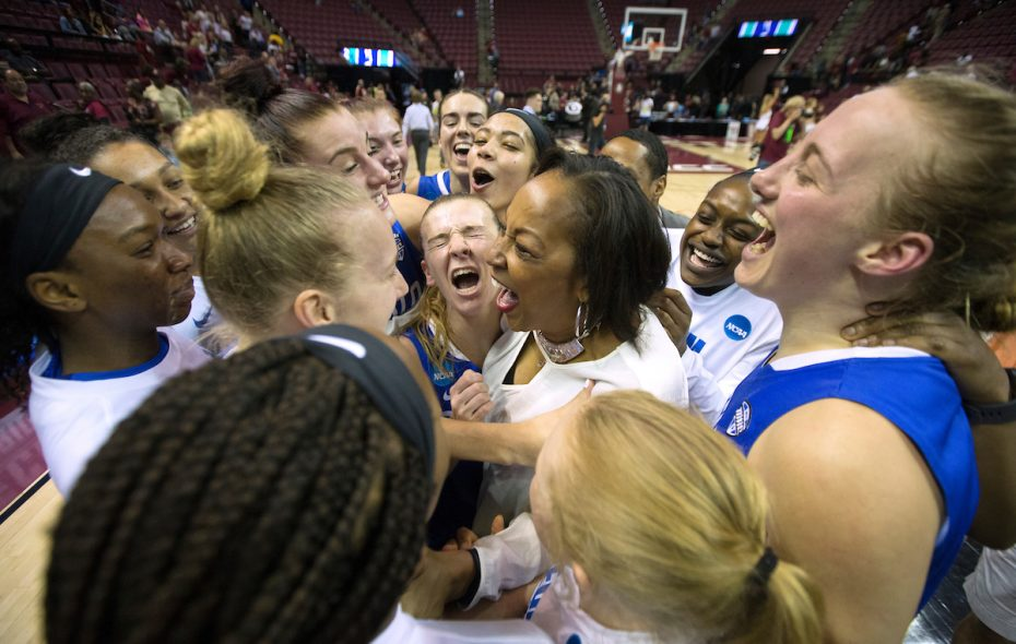 Buffalo Bulls head coach Felisha Legette-Jack, center, and the rest of her team celebrate their victory over Florida State, which earned them a trip to the Sweet 16. (Mark Wallheiser/University at Buffalo)