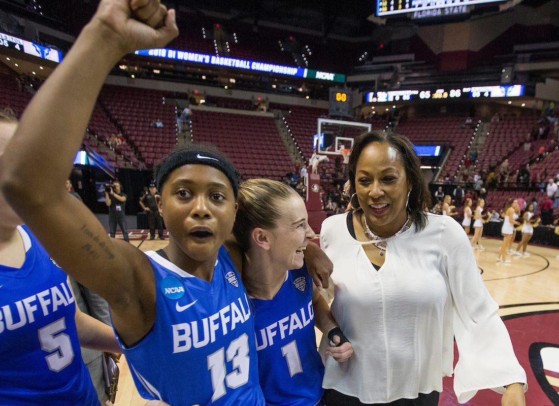 Buffalo guard Autumn Jones, left, guard Stephanie Reid, center, and head coach Felisha Legette-Jack celebrate defeating Florida State. (Mark Wallheiser/University at Buffalo)