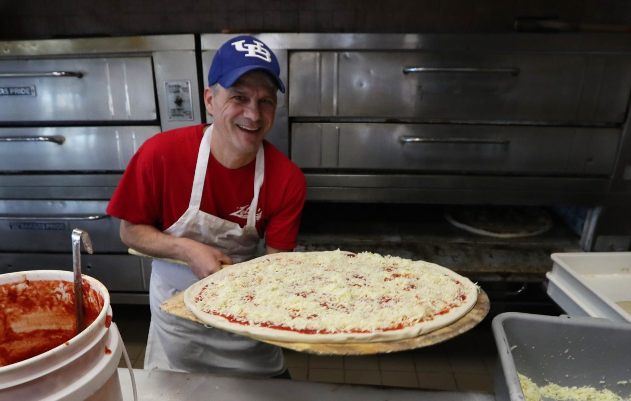 Zetti's Pizza & Pasta owner John Fusco makes one of the 24-inch house pies. (Sharon Cantillon/Buffalo News)