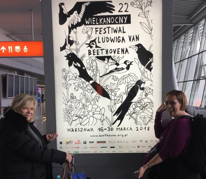 BPO board member Cindy Abbott Letro and BPO English horn player Anna Mattix rejoice at the sight of a poster advertising the Warsaw Beethoven Easter Festival. The invitation to perform at that festival is what sparked the BPO's tour of Poland. (Photos courtesy BPO Executive Director Dan Hart.)