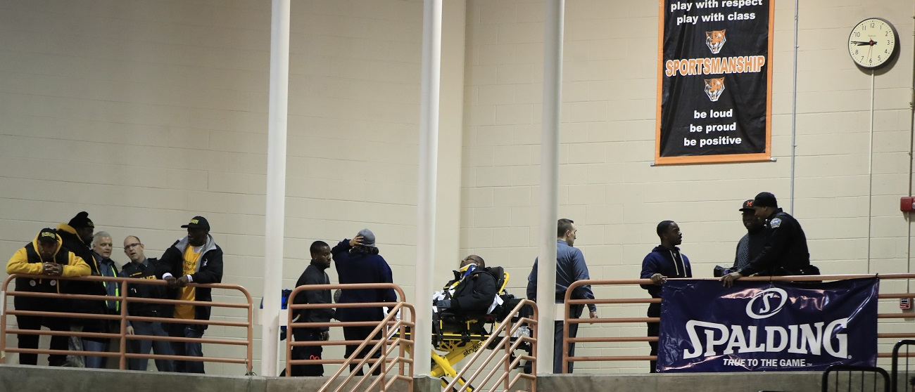 One Buffalo Peacemaker  was taken to the hospital after trying to break up a fight a fight in the stands during a high school playoff basketball game at Buffalo State Sports Arena on Tuesday night. (Harry Scull Jr./Buffalo News)