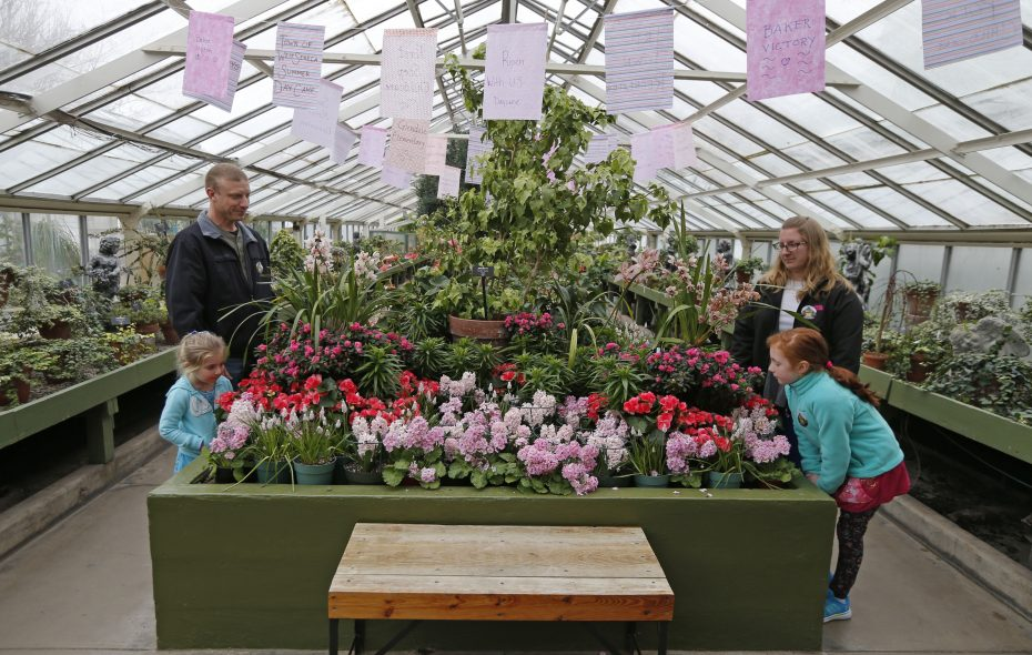 The Bos family, from left, Jim and Emily, 4, Amy and Leah, 8,  from the Town of Niagara enjoy the fragrances of spring flowers during the annual spring flower show at the Buffalo and Erie County Botanical Gardens.  (Robert Kirkham/Buffalo News)