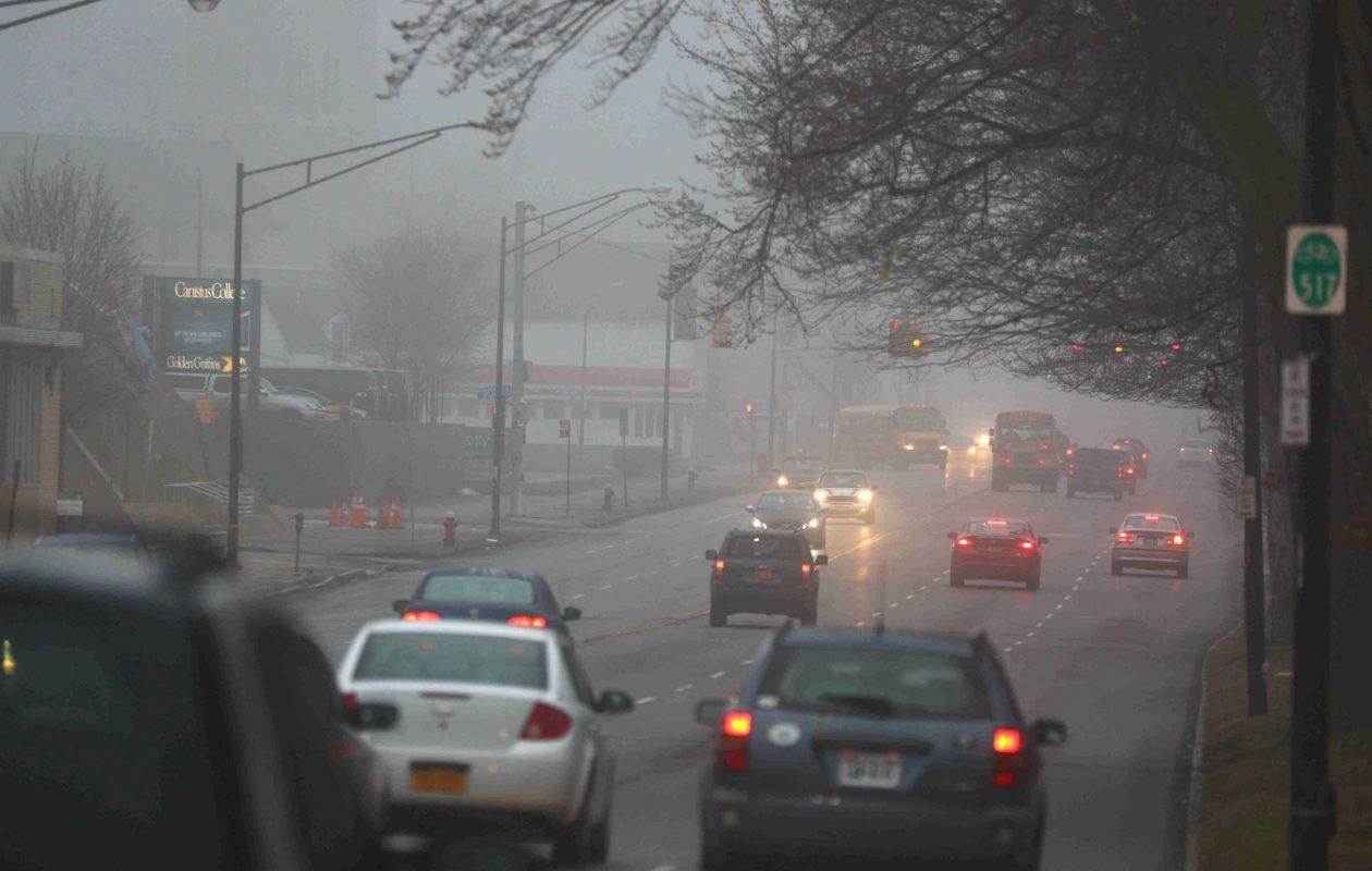 Commuters make their way through the morning fog on Main Street in Buffalo Thursday. (John Hickey/Buffalo News)