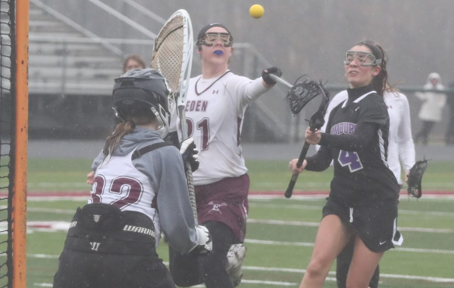 Hamburg's Maddy Reardon scores a goal on Eden's Adrianna Harman in the first half during girls lacrosse at Eden high school in Eden N.Y. on Thursday, March 29, 2018.  (James P. McCoy/Buffalo News)