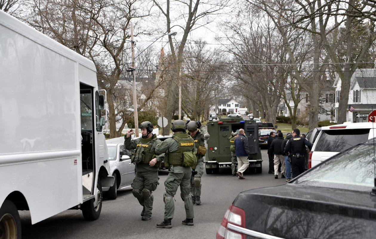 Numerous law enforcement agencies respond to a report of a man who has barricaded himself in an apartment in the Village of Lewiston on Tuesday, March 27, 2018. (Larry Kensinger/Special to the News)