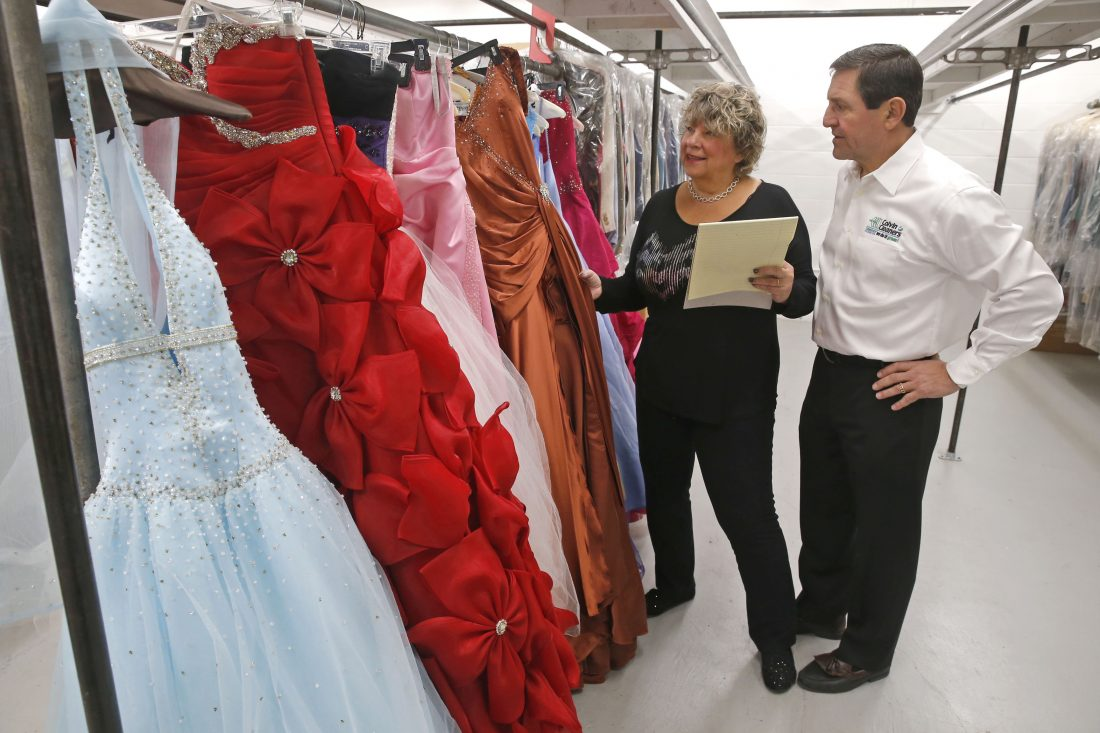 Paul and Cyndee Billoni get ready for Gown for Proms at Shea's Performing Arts Center. (John Hickey/News file photo)