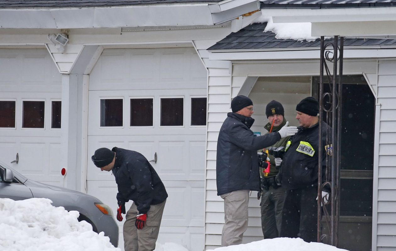 Investigators inspect the scene outside a home on Route 246 in Perry on Thursday, the day after a retired sheriff's deputy was charged with fatally shooting a man in the deputy's driveway.  (Robert Kirkham/Buffalo News)