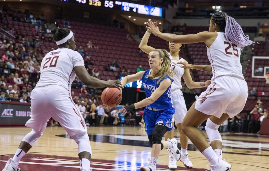 UB senior point guard Stephanie Reid dishes out assists, and compliments, for the Bulls. (Mark Wallheiser/University at Buffalo)