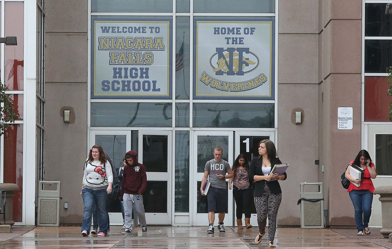 {for local} Students leave Niagara Falls High School at dismissal time on, Tuesday, Sept. 18, 2012.  {Photo by Robert Kirkham / Buffalo News}
