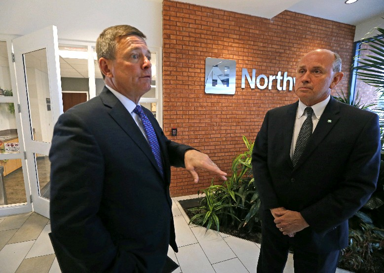 Northwest Bank President and COO Ronald Seiffert (left) and Steven Fisher, chief revenue officer, at the bank's regional headquarters. (Robert Kirkham/Buffalo News)