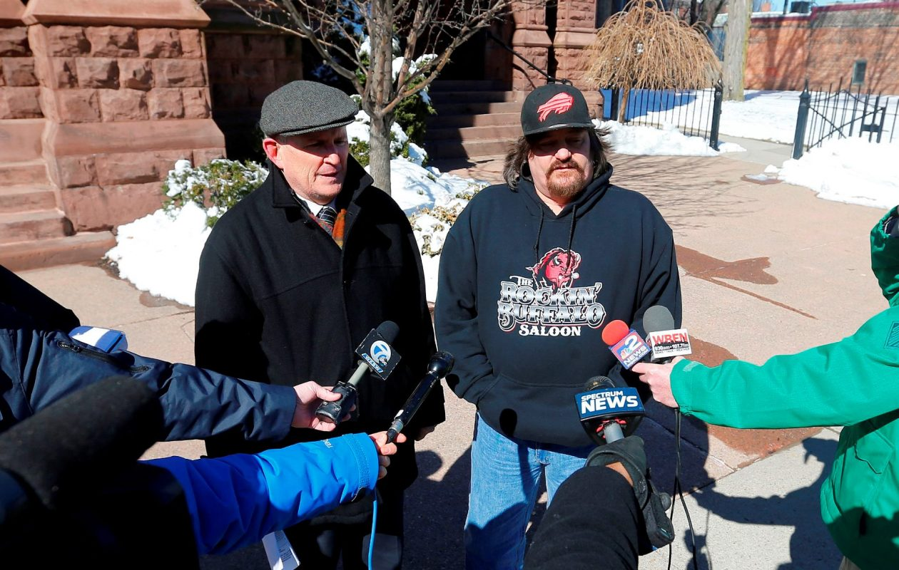 Robert M. Hoatson, left, and abuse victim Michael Whalen, right, speak to reporters during a press conference outside St. Louis Church on Main Street on Sunday, March 4, 2018. (Mark Mulville/Buffalo News)