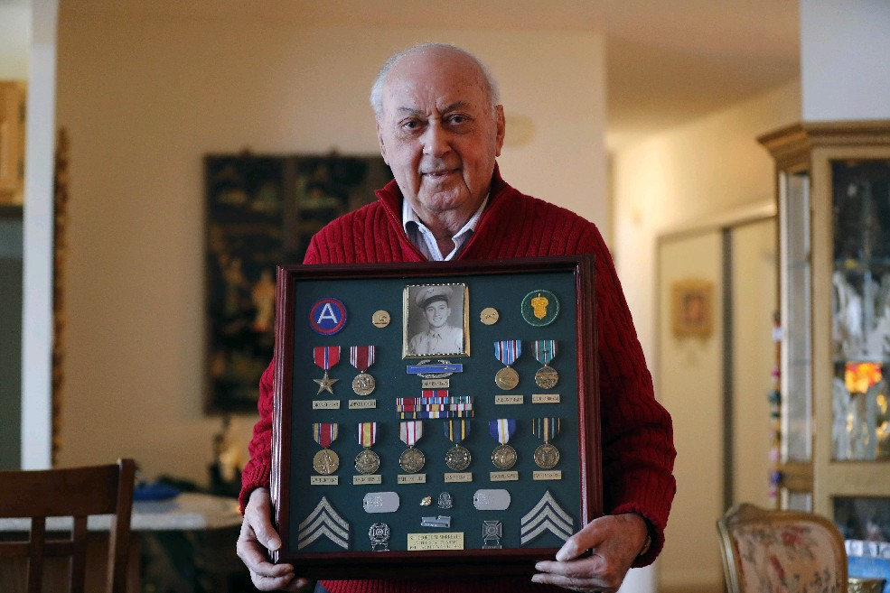 World War II infantry squad leader George  M. Morreale spent seven days and nights in a foxhole, then had to learn to walk again after discovering his feet had become frostbitten. (Mark Mulville/Buffalo News)