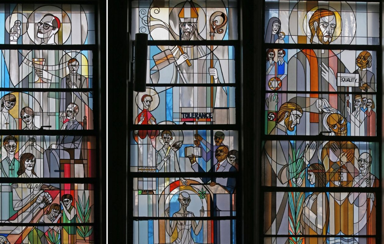 The windows of St. Ambrose include the Window of the Martyrs, left, including Archbishop Oscar Romero, slain in El Salvador in 1980, and two Buffalo priests slain in 1987. The Window of the Prophets, center, includes Dr. Martin Luther King Jr. and Mohandas Gandhi. St. Peter Claver, who ministered to slaves, is depicted in the Mission Church window at right. (Robert Kirkham/Buffalo News)