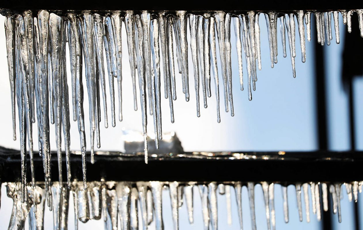 Icicles hang from the exterior of Genesee Street building in Buffalo. (Sharon Cantillon/Buffalo News)
