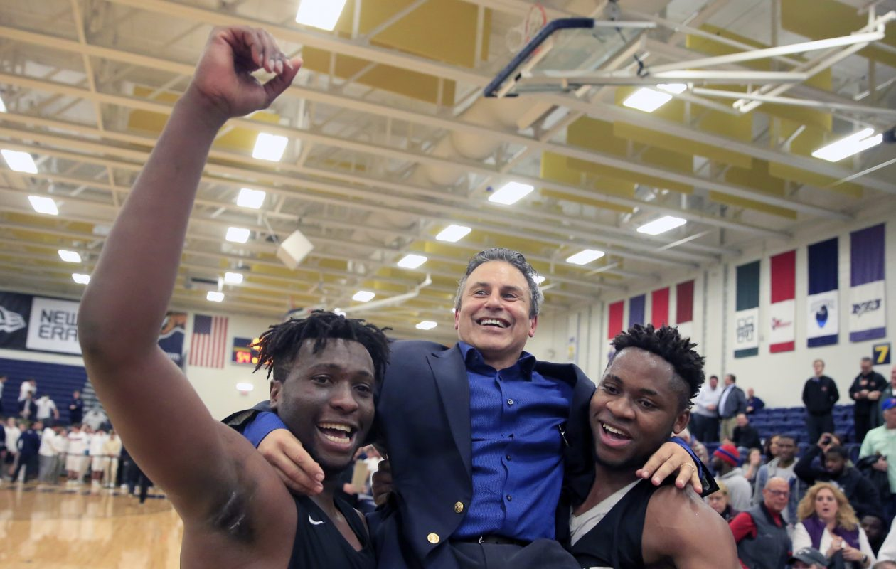 Park players Julian Eziukwu and Quentin Nnagbo give head coach Rich Jacob a lift after winning the Manhattan Cup Class A crown. The Pioneers followed that by capturing the state Catholic title and Federation crown as the overall state champion in Class A. (Harry Scull Jr./ Buffalo News)