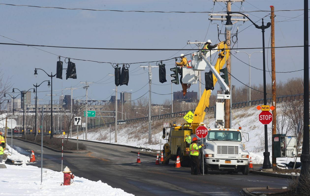 Workers install traffic signals on Fuhrmann Boulevard in anticipation of construction on the Skyway.  (John Hickey/Buffalo News)