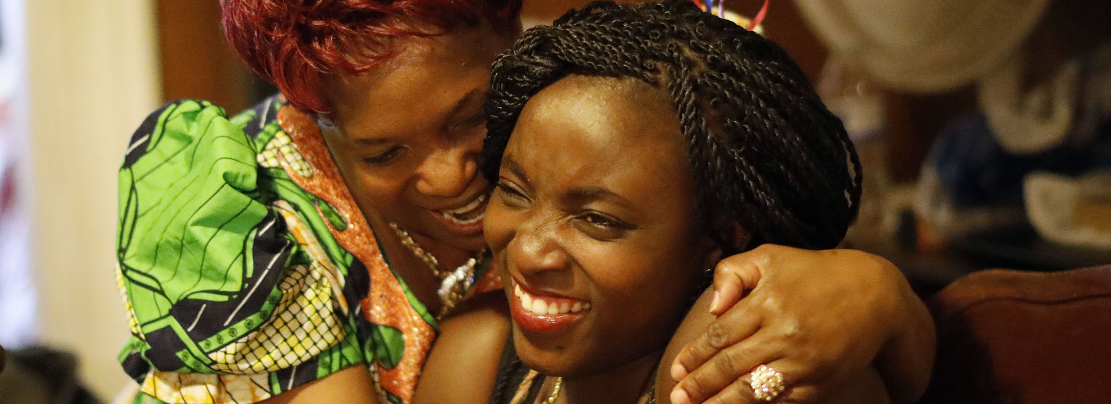 As the family celebrates Agath's arrival, her mother, Micheline, can't resist taking any opportunity to squeeze her daughter, the night that she arrived home.  'This is not a dream!' she exclaimed.  (Derek Gee/Buffalo News)