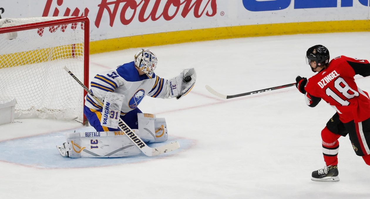 Chad Johnson, gloving a breakaway chance by Ottawa's Ryan Dzingel, was joined on the road trip by fellow goalies Linus Ullmark and Adam Wilcox. (Harry Scull Jr./Buffalo News)