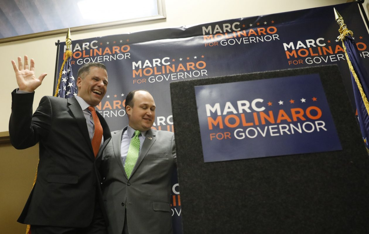 New York GOP gubernatorial candidate Marc Molinaro, Dutchess County Executive, takes the stage as he is introduced by Erie County GOP Chairman Nick Langworthy, right, at the Erie County GOP headquarters in Buffalo, Wednesday, April 4, 2018.  (Derek Gee/Buffalo News)