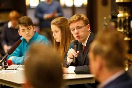 Clarence High School student Andy Kowalczyk, 17, of Students For Action, asks a question of panelists Rep. Brian Higgins and Grand Island Supervisor Nate McMurray who is running for congress, during a forum on gun violence at St. Paul's Episcopal Cathedral.