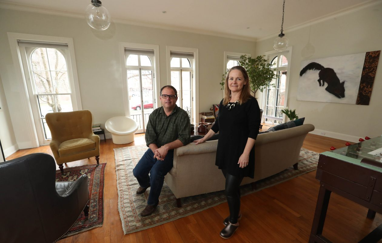 Charlie von Simson and Erin St. John Kelly had the living room renovated. The ceiling was returned to its original height, the windows restored and the floors refinished.   (Sharon Cantillon/Buffalo News)