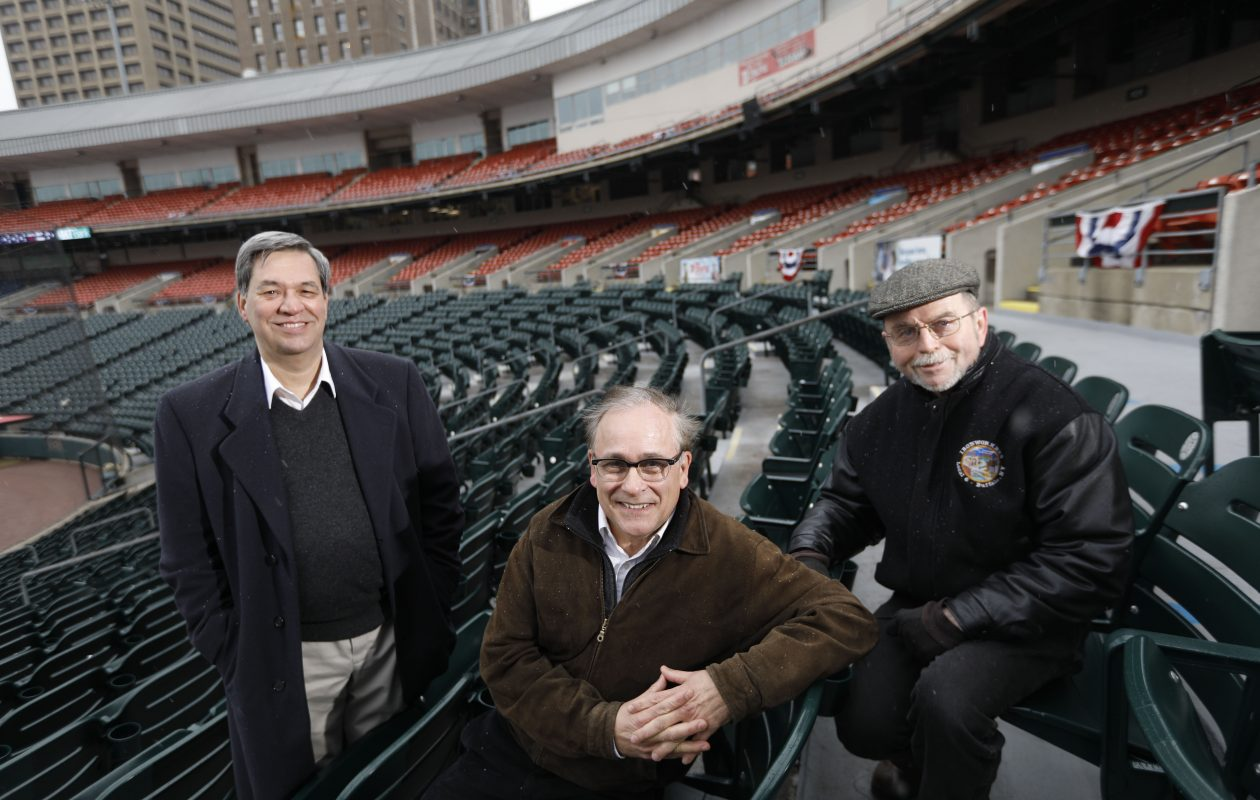 From left, Paul Battaglia, Tim Tielman and Bill Murphy at Coca-Cola Field, with city towers rising behind them: Remembering how Buffalo got a ballpark that meshed with the city around it. (Derek Gee/Buffalo News)