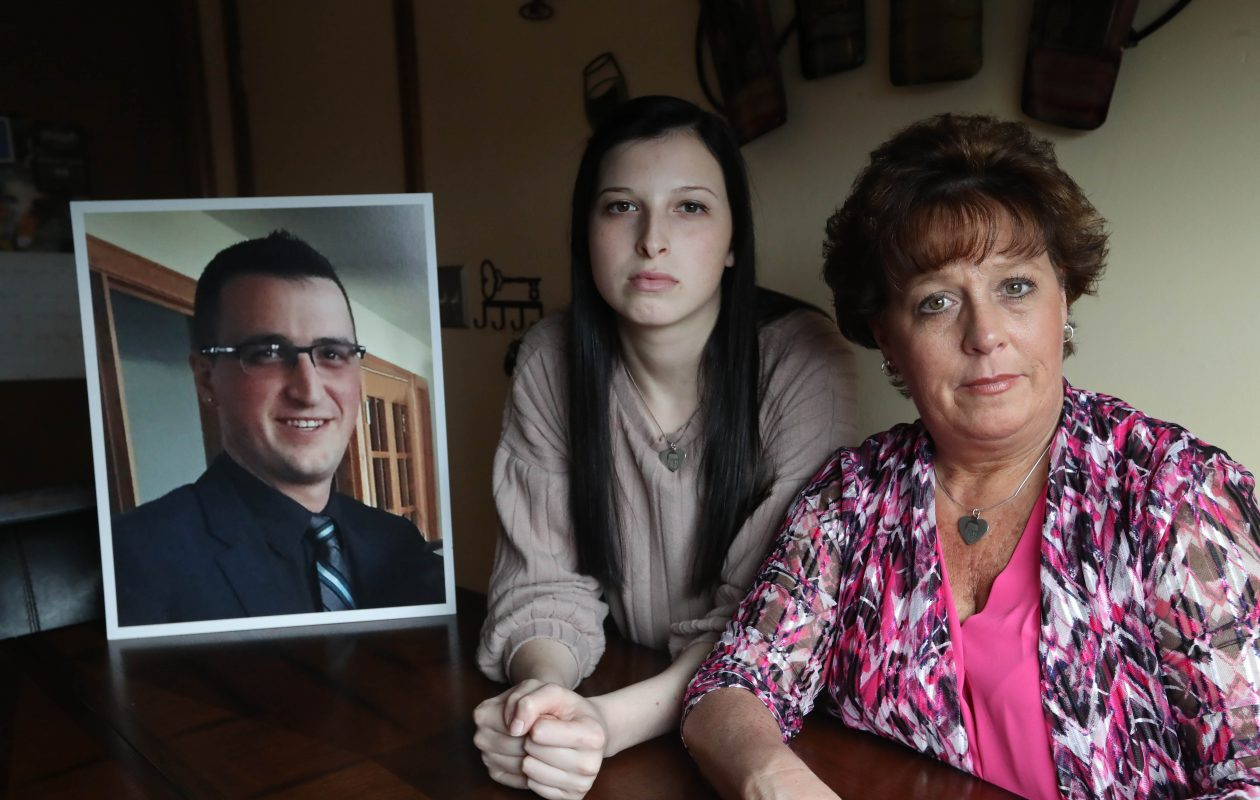 Cheektowaga Councilwoman Christine Adamczyk lost her son Danny a year ago to a heroin overdose.  He was an EMT who fell on the job and became addicted to painkillers.  The Town of Cheektowaga recently filed suit against opioid manufacturers.  She's at home with her daughter Brittany, 20, Thursday, April 12, 2018.  Both got tattoos of purple ribbons symbolizing overdose awareness. (Sharon Cantillon/Buffalo News)