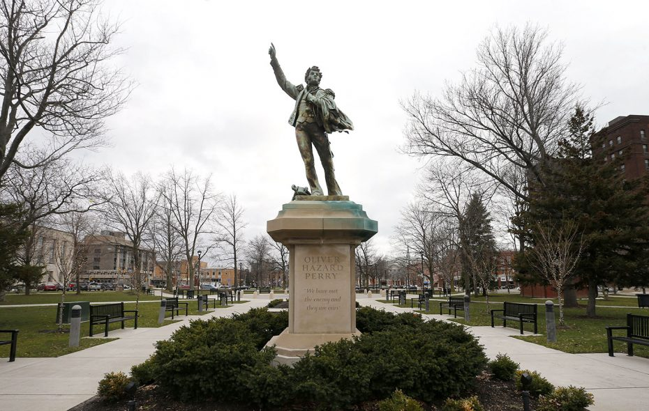 The statue of Oliver Hazard Perry stands among green bushes in Perry Square in Erie, Pa., on April 19. (Mark Mulville/Buffalo News)