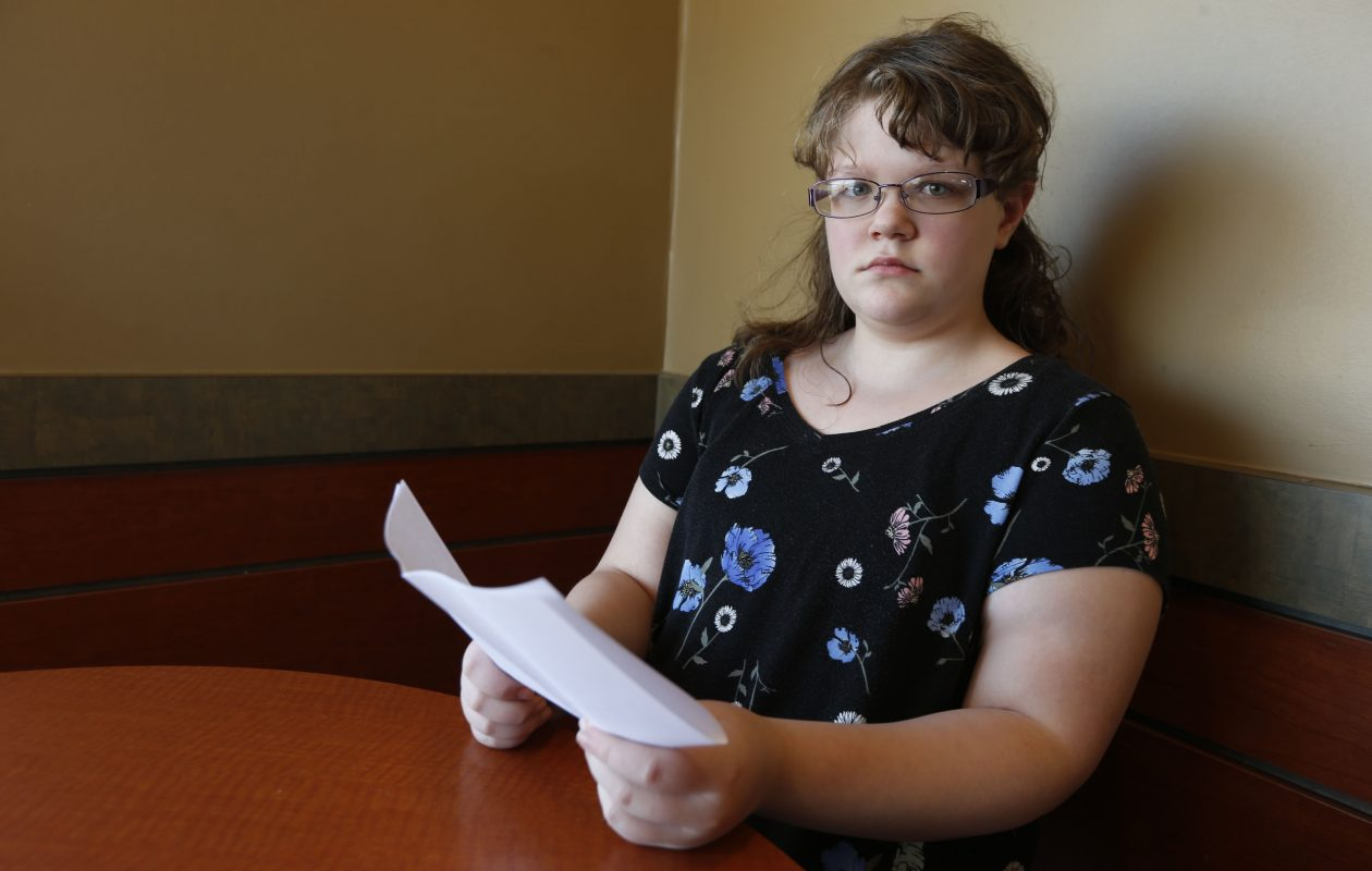 Starleana Breisch, 10, lost her mother, Michelle Breisch, a month ago in a terrible accident in North Tonawanda. She holds an essay she wrote about her mother at a Tonawanda coffee shop on Monday, April 23, 2018. (Robert Kirkham/Buffalo News)