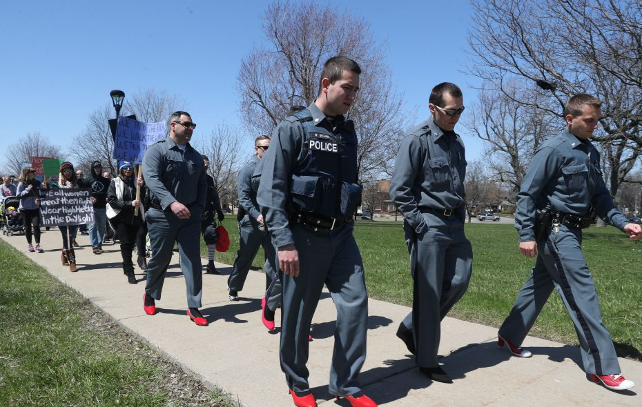 Some UB Campus Police officers don heels to raise awareness about sexual assault as part of the annual Mile in Her Shoes event Sunday. (John Hickey/Buffalo News)