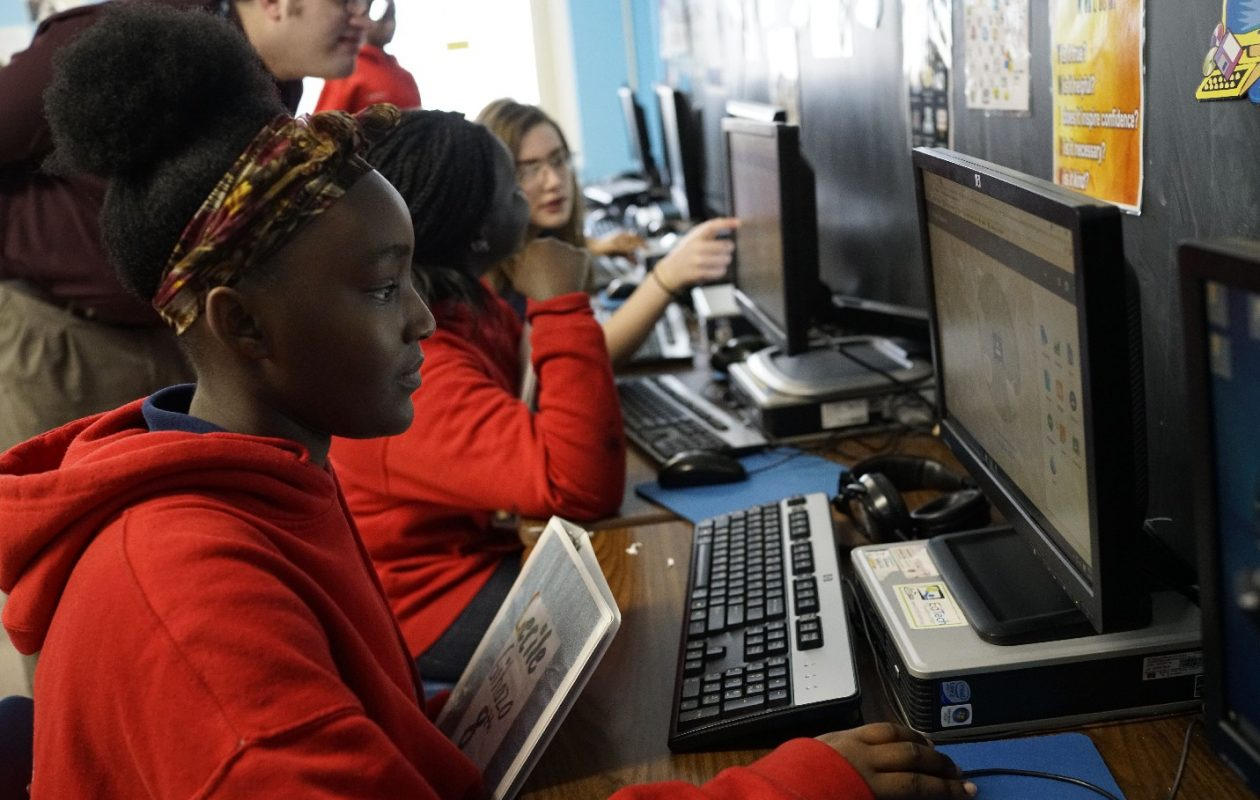 Eighth grade student Cecile Gihozo, 14, works on a project during writing innovations class at Our Lady of Black Rock School, Tuesday, April 10, 2018. The students at this school, and the 30-year-old story of Buffalo's baseball stadium, tell a story about Buffalo. (Derek Gee/Buffalo News)