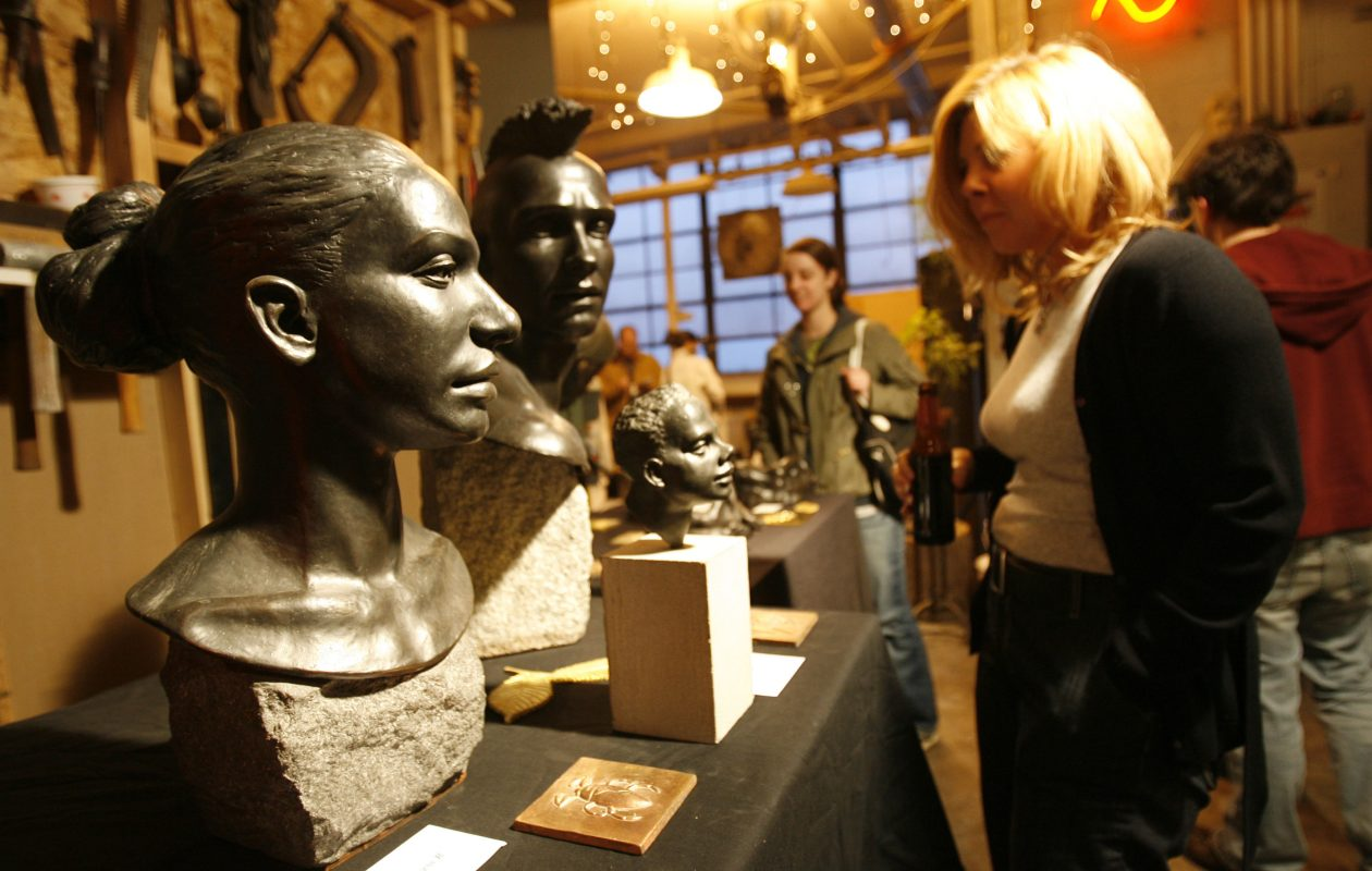 "Danielle Tabone of Orchard Park examines David Derner's bronze sculpture, ""The Princess R,"" at the 2008 version of Trimania, in the Tri-Main Center on Main Street. (Sharon Cantillon/Buffalo News file photo)"
