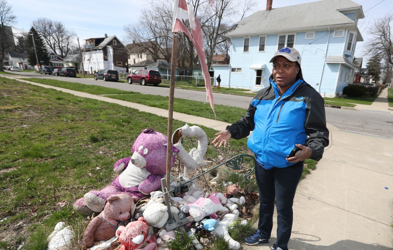 A memorial remains at a vacant lot at 90 Humber Ave. in Buffalo on Friday, April 27, 2018. A house fire killed three people there in February 2016, including 8-year-old Treasure Brighon.  Neighbor Sharon Mack said she helped Treasure when the girl ran out of the burning house. She said she will never forget the sight of Treasure as long as she lives. (Sharon Cantillon/Buffalo News)