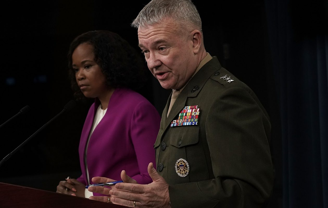 Pentagon Chief Spokesperson Dana W. White (L) and Marine Lt. Gen. Kenneth F. McKenzie Jr. (R), participate in a news briefing at the Pentagon April 14, 2018 in Arlington, Virginia.  (Getty Images)