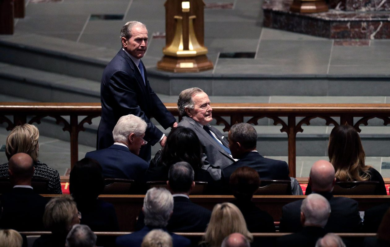 Former Presidents George W. Bush and George H.W. Bush arrive as they pass by former first lady Hillary Clinton, former President Bill Clinton, former first lady Michelle Obama, former President Barack Obama and first lady Melania Trump at St. Martin's Episcopal Church for a funeral service for former first lady Barbara Bush, April 21, 2018 in Houston, Texas. Bush, wife of former president George H. W. Bush and mother of former president George W. Bush, died at her home in Houston on April 17 at the age of 92.  (Photo by David J. Phillip-Pool/Getty Images)