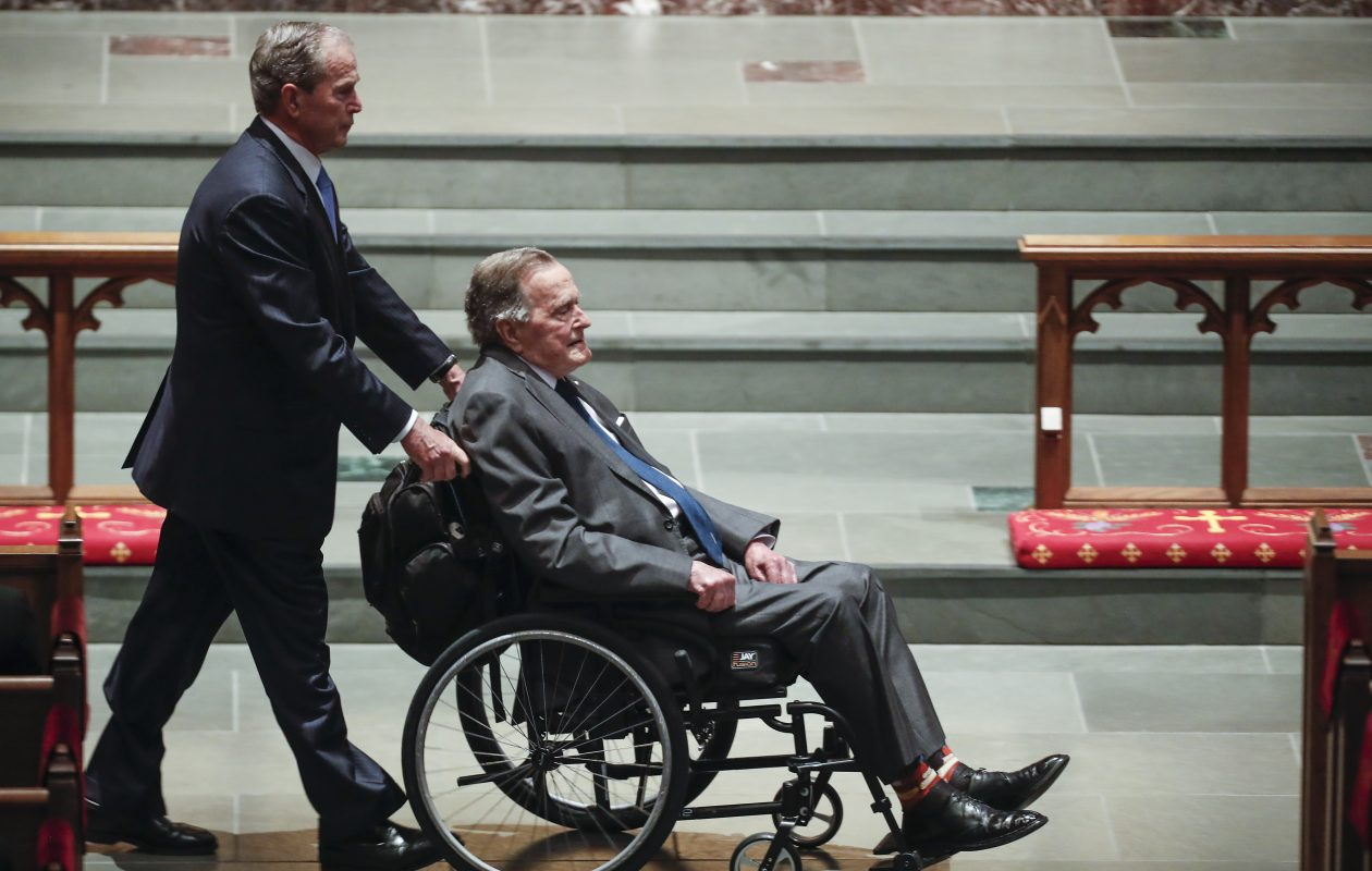 Former president George W. Bush, left, wheels his father, former president George H.W. Bush into the church for the funeral for former first lady Barbara Bush at St. Martin's Episcopal Church on April 21, 2018. The senior Bush died Nov. 30. (Getty Images file photo)